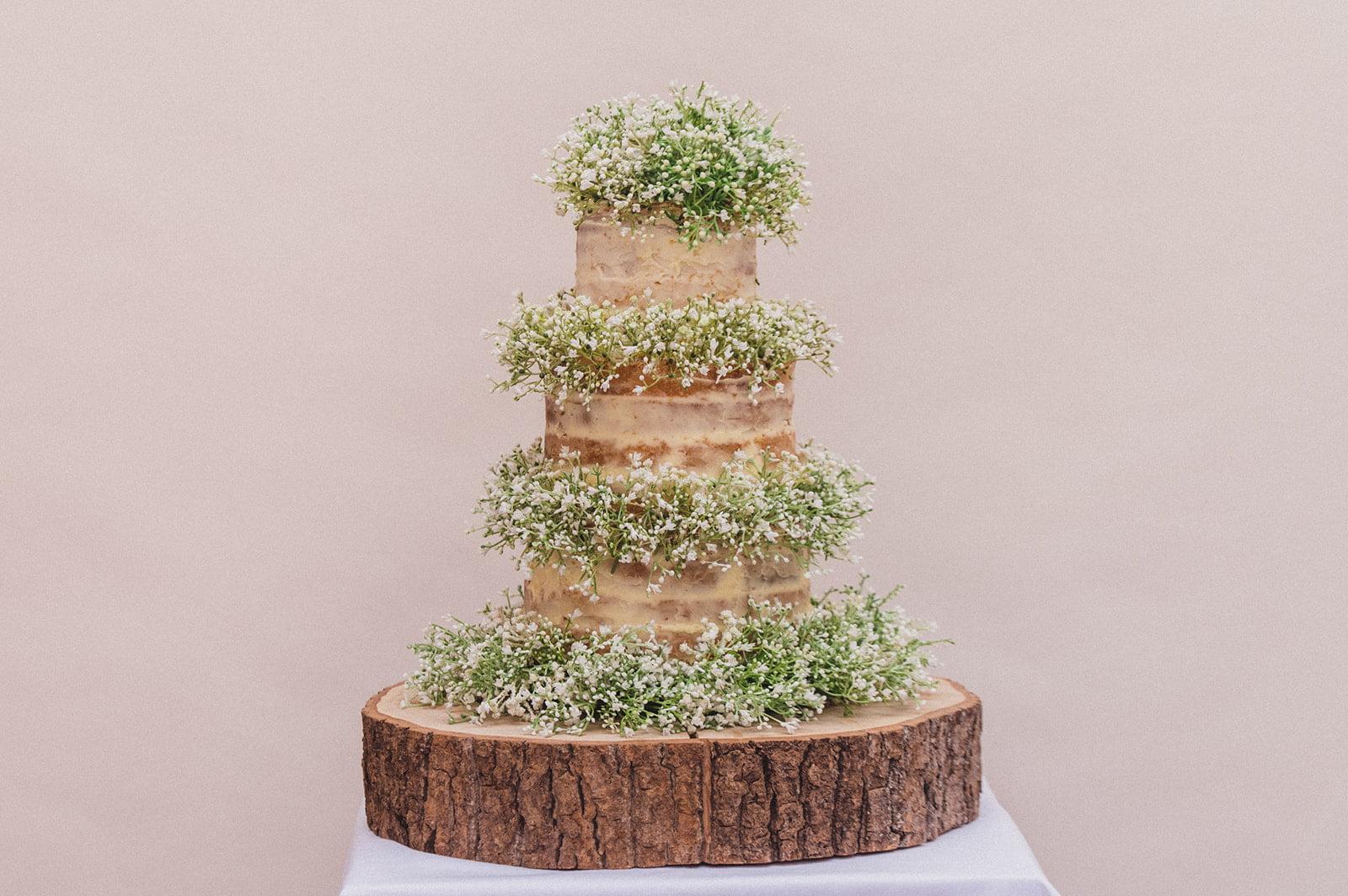 Nearly Naked Wedding Cake filled with Gypsophila flowers