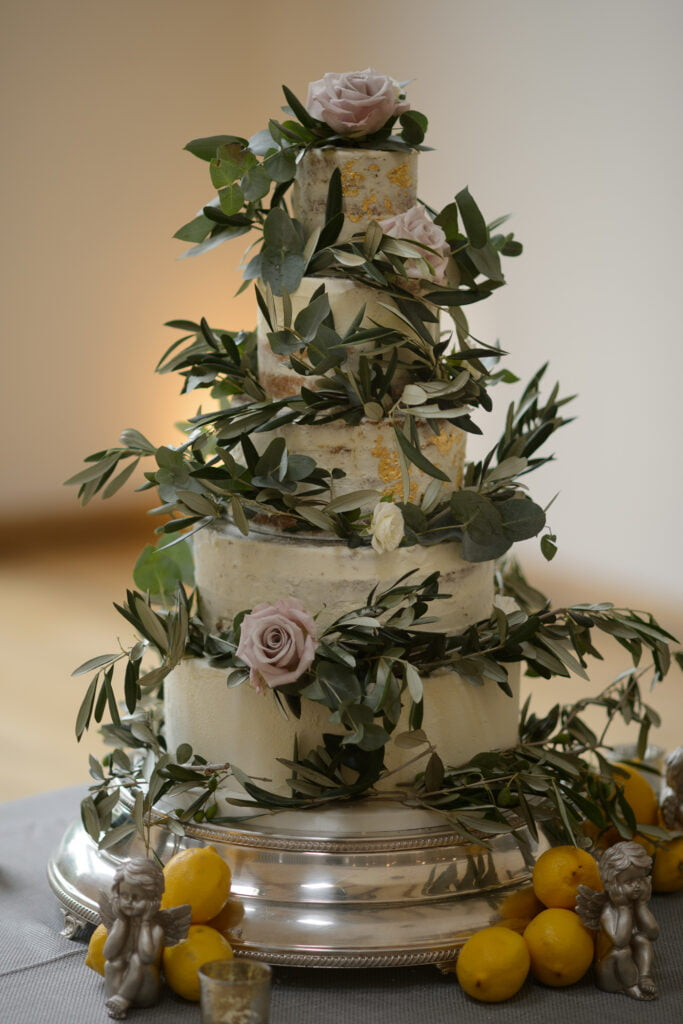 4 Tier Nearly Naked Wedding Cake Filled with Eucalyptus and Blush Pink Roses