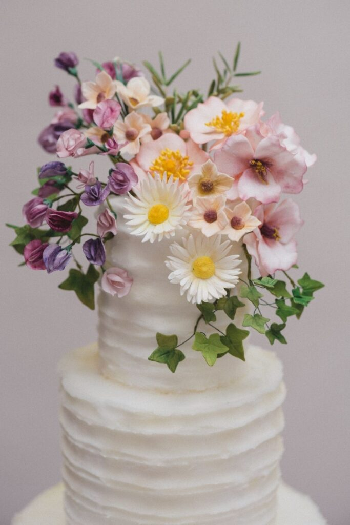 Wild Sugar flowers for cakes including handmade daisies, dog roses and ivy garland