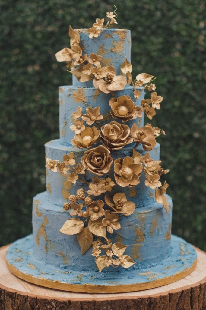 Four Tier Cornflower blue buttercream filled with hand painted gold flowers - the ultimate gold wedding cake