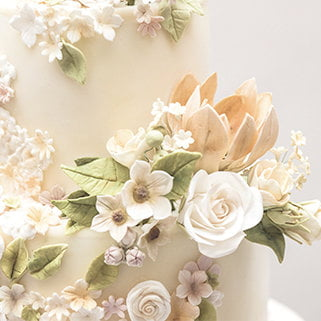 Close up of whimsical wedding cake designed by Bluebell Kitchen in their studio in Maidstone, Kent