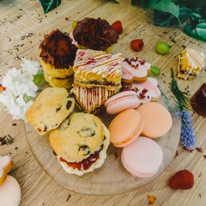Selection of Afternoon Tea treats - mini chocolate cakes, blondies, macarons, cookies, scones