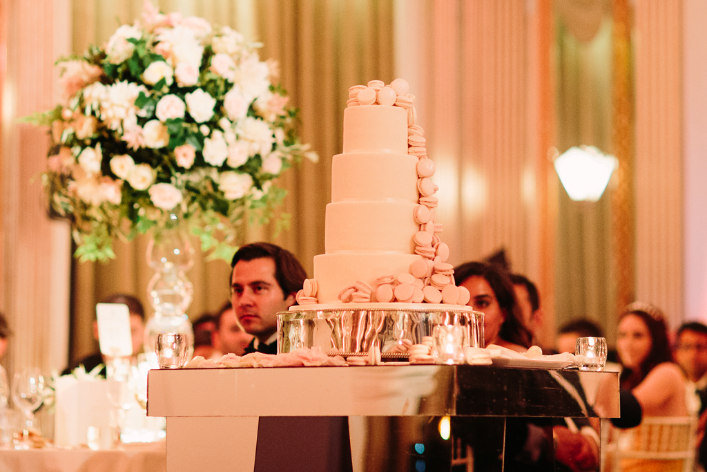 Macaron cascade wedding cake on the dance floor in pink ombré hues