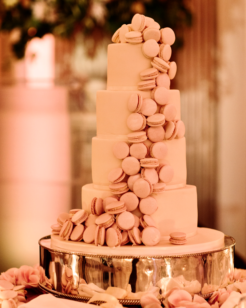 Luxury cascade of delicate ombre pink macarons on a four tier wedding cake at Claridges