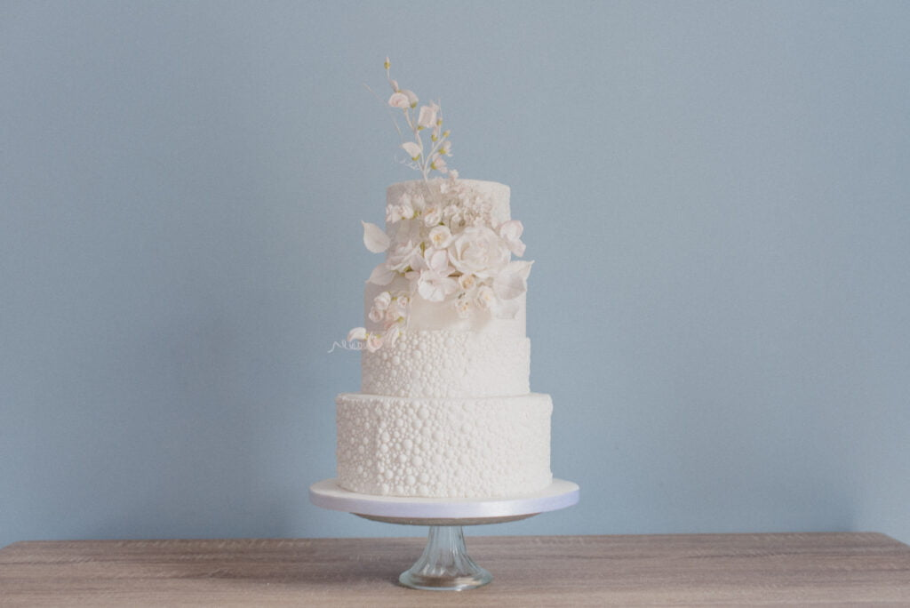White Textured Micro Wedding Cake filled with Handmade Sugar Flowers designed by Bluebell Kitchen