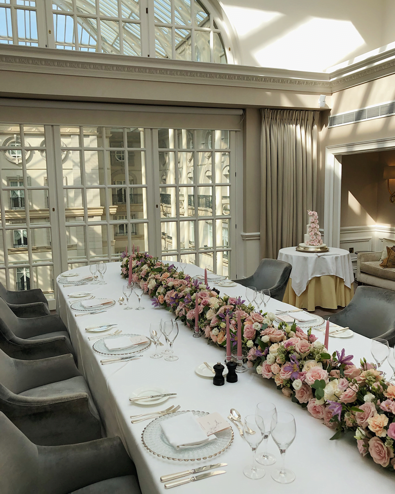 Reception room at The Landmark Hotel filled with blush pink flowers