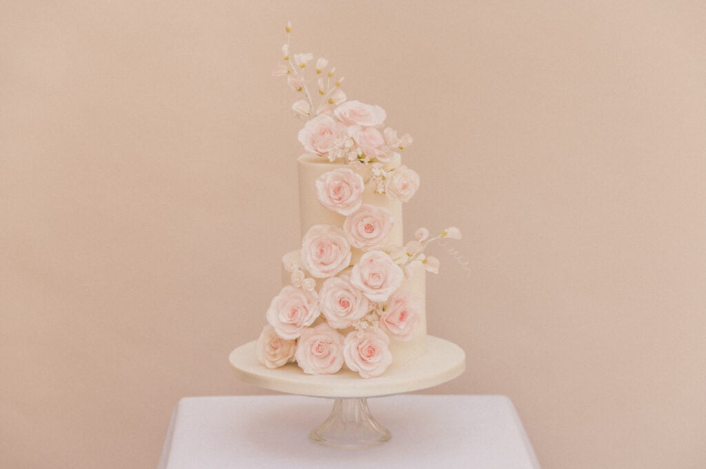 Three tier micro wedding cake cascading sugar roses designed by Bluebell Kitchen