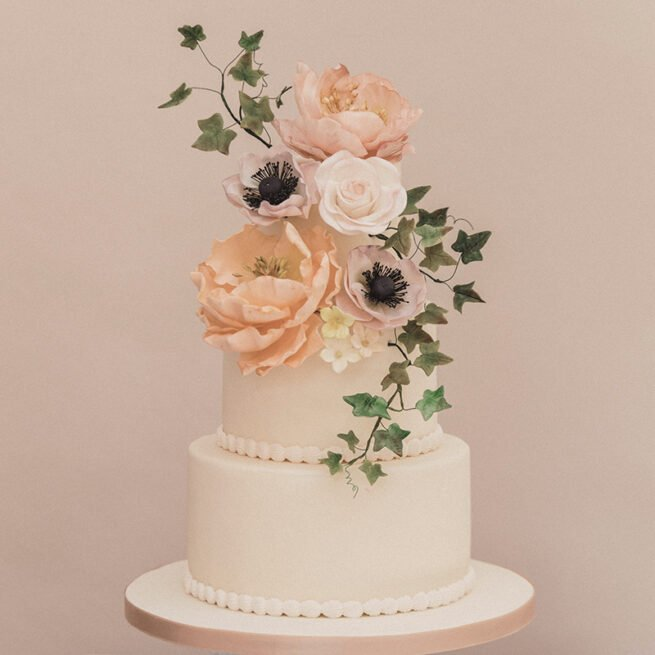 Sugar flower three tier wedding cake class filled with peonies, roses, ivy and anemones
