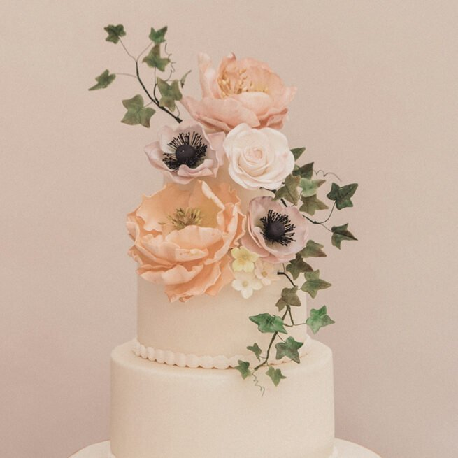 Close up of sugar flowers including peonies, roses, ivy and anemones