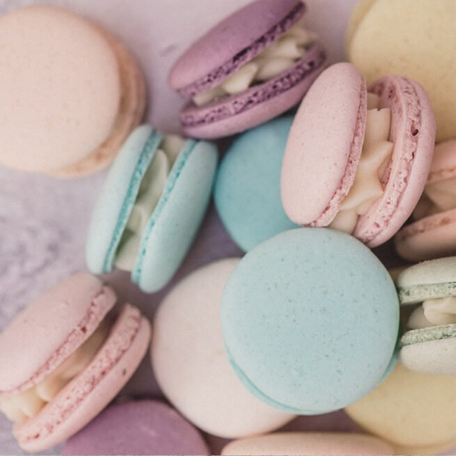 Handmade pastel pink, turquoise, lemon yellow, peach and lilac macarons
