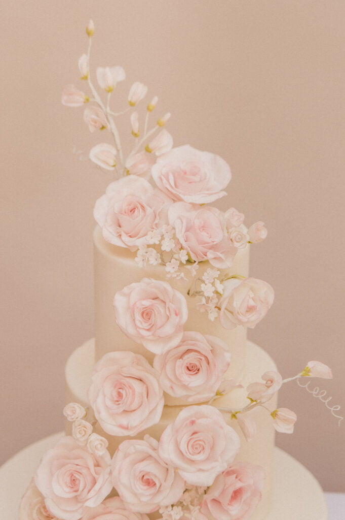 Cascade of handmade white sugar roses with a hint of pastel pink