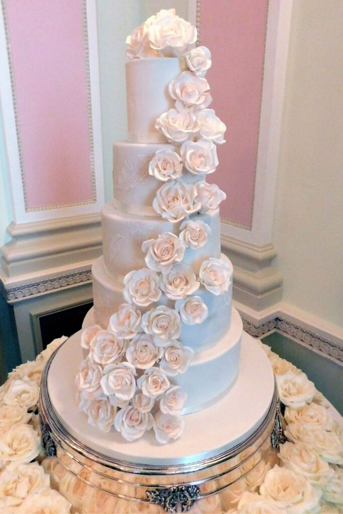 Sweeping cascade of Bridal white sugar roses Ritz Wedding Cake for Claire Chanelle