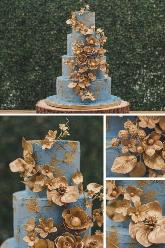 Hand painted gold sugar flowers close up on a cornflower blue buttercream wedding cake