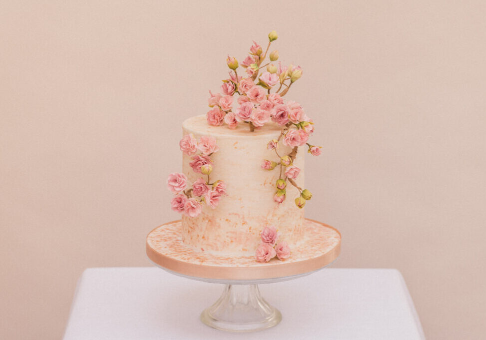 Single tier micro wedding cake with handmade sugar cherry blossoms designed by Bluebell Kitchen