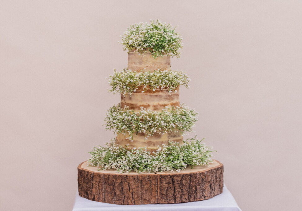 Nearly Naked Wedding Cake filled with Gypsophila flowers