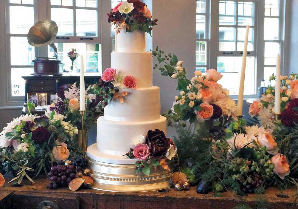Bluebell Kitchen four tier sugar flower romantic wedding cake at The Globe Theatre